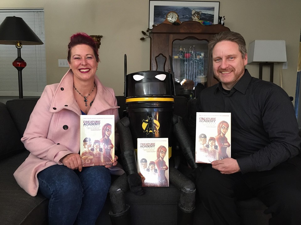 First Vice President Heidi Spidey, HitchBAT, and President Dale at Hilja's house with Kevin Konrad Hanna's excellent Creature's Academy hardcover comics! Part of Yasmeen's donation to Seattle Children's Hospital!