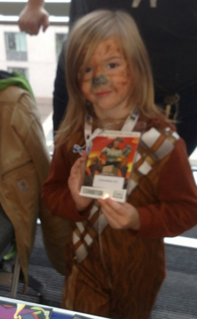 Iris first comic con! with her Comics4Kids INC badge! @ jet city comic show 2015
