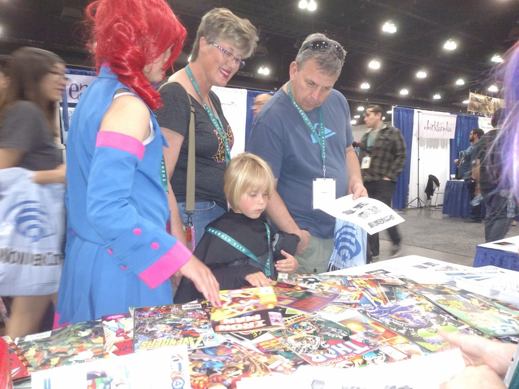 Mom and Dad helping select a good comic!